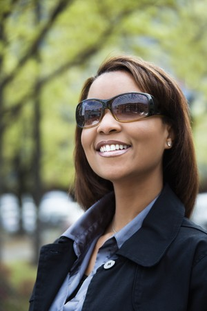 Portrait of African American woman wearing sunglasses and smiling. photo