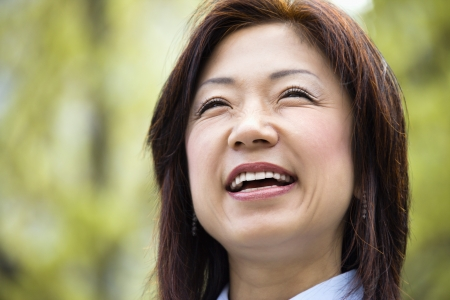Portrait of smiling Asian woman. photo
