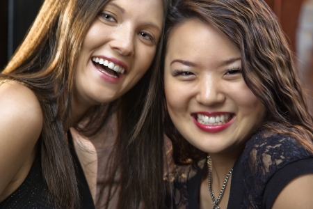 Portrait of two pretty smiling young women. Stock Photo - 6908252