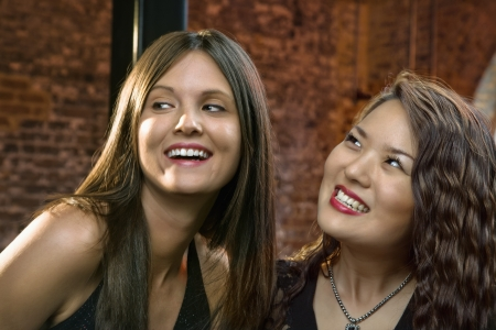 Portrait of two pretty smiling young women. Stock Photo - 6924800