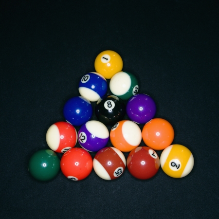 Pool tables arranged in triangle on pool table. Stock Photo - 6924787