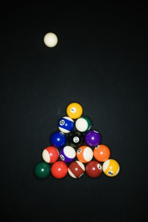 Pool tables arranged in triangle on pool table with cue ball. Stock Photo - 6924777