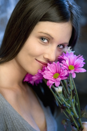 Portrait of pretty young Caucasian woman holding bouquet of flowers. Stock Photo - 6924797