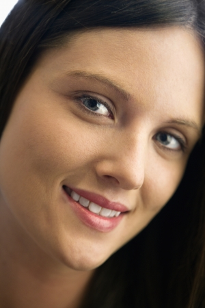 Close up of pretty young brunette Caucasian woman smiling. Stock Photo - 6924763