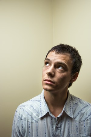Portrait of young Caucasian man looking up. Stock Photo - 6924734