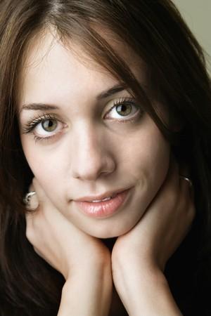 Portrait of pretty young brunette woman. Stock Photo - 6924759