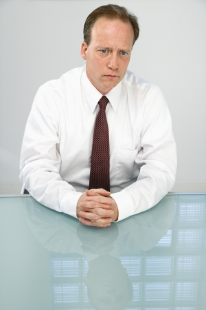 Portrait of Caucasian middle aged businessman sitting at desk. Stock Photo - 6924709