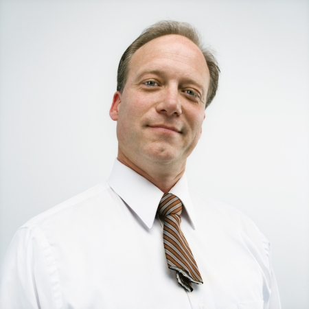 Caucasian middle aged businessman portrait with cut necktie. photo