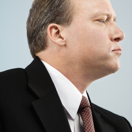 Caucasian middle aged businessman profile portrait. Stock Photo - 6924783