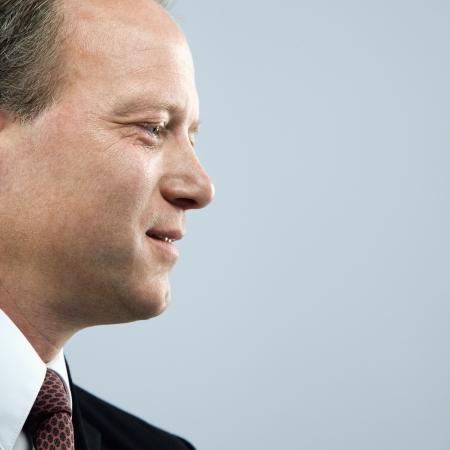 Caucasian middle aged businessman profile portrait. photo