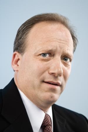 Portrait of Caucasian middle aged businessman. photo