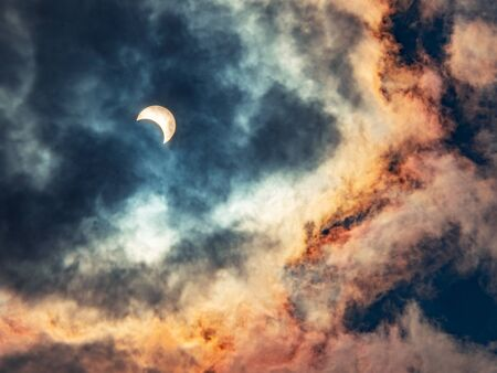 Solar eclipses caused by the shadow of the moon covering the sun In the midst of thick clouds, the end of the year 2019