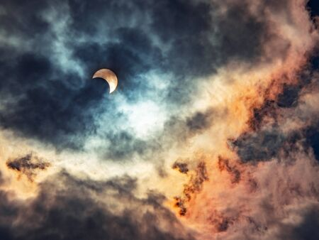 Solar eclipses caused by the shadow of the moon covering the sun In the midst of thick clouds, the end of the year 2019 Stock Photo - 138457338