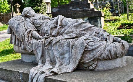 statue of a dead girl lying, Luchakov cemetery, Lviv, Ukraine photo
