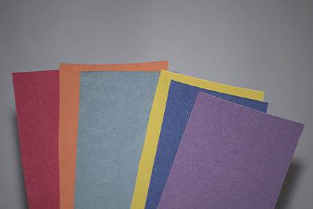 Colored paper on background white Stok Fotoğraf
