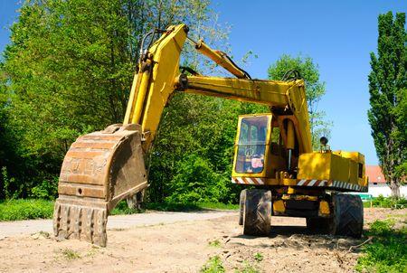 Yellow excavator with a big backhoe