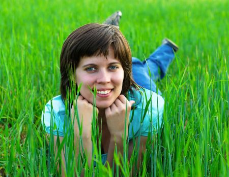 Young girl, lying on green grass  Stock Photo