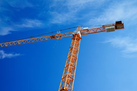 Building crane with the sky background