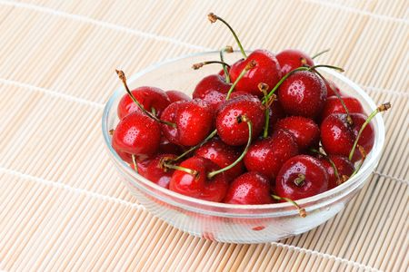 bacca: Fresh sweet cherry with a water drops Stock Photo