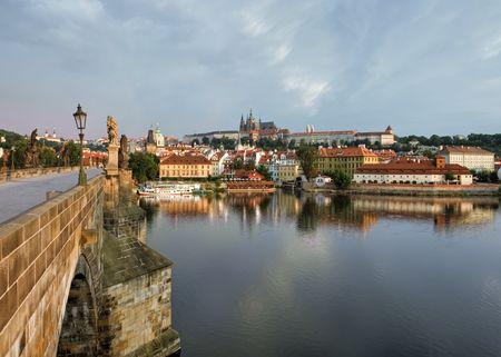 Prague Castle and Charles bridge at sunrise  Stock Photo