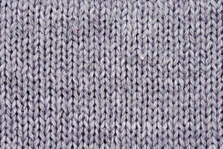Gros plan de la texture de la laine tricoté. Gray