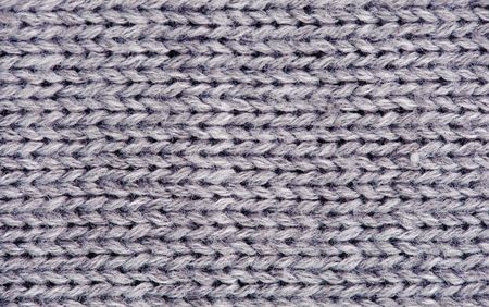 Close-up of knitted wool texture. Gray