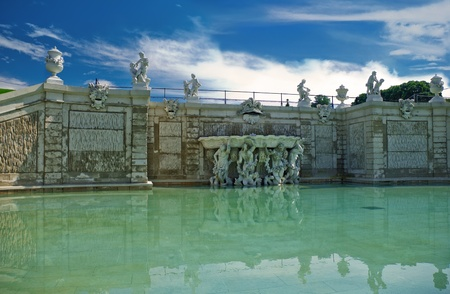 Pond with sculptures near the Belvedere palace in Vienna  Austria photo