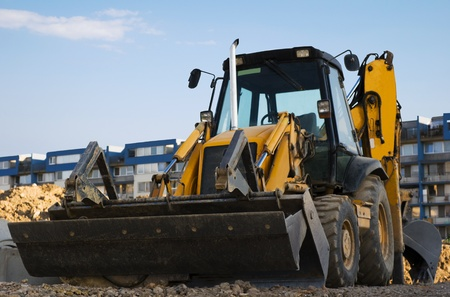 Excavator with a backhoe on the construction area Stock Photo - 8404966