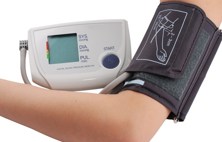Blood pressure monitor in action. Patient hand with cuff photo