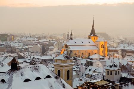 Winter snow Prague at sunset. Czech Republic