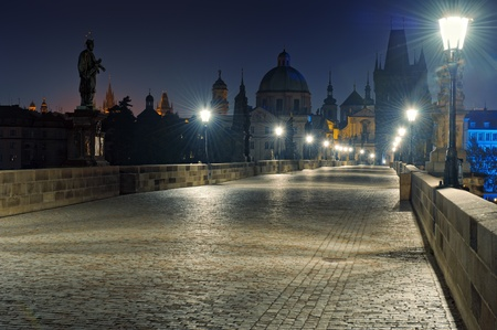 Prague Charles bridge at dawn photo