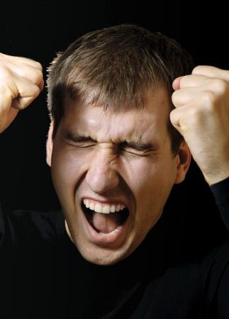 mouth pain: Screaming men. Emotional men in stress Stock Photo