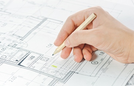 Hand and architectural project Stock Photo - 11570244
