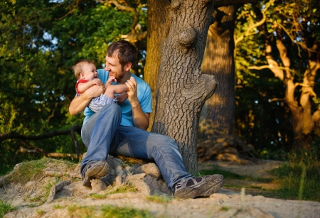 Father with his son in a park at sunset. Stock Photo