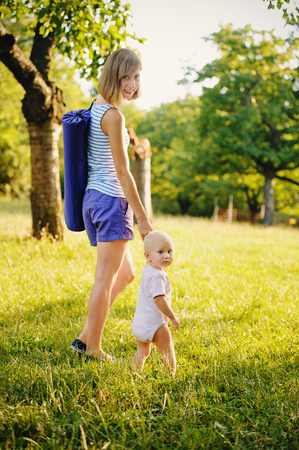 Mother and her daugther going for yoga class Stock Photo