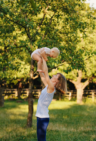 Mother and her daugther practice yoga Stock Photo