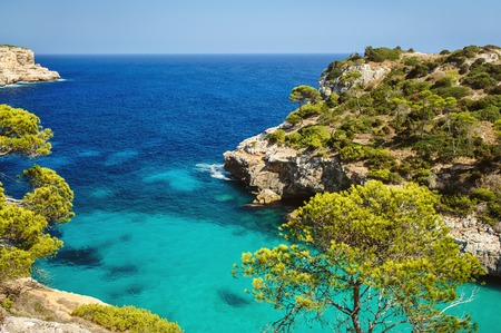 majorca: Beautiful beach bay azure sea water, Cala des Moro, Majorca island, Spain Stock Photo