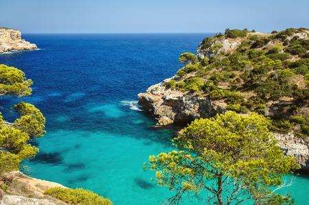 spain: Beautiful beach bay azure sea water, Cala des Moro, Majorca island, Spain Stock Photo