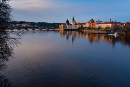 Viewof Charles Bridge at sunset and city view in Prague. Czech Republic. View of Moldavia river.
