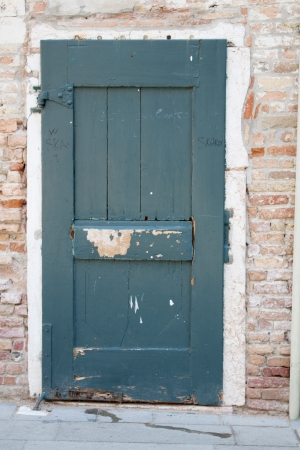 Old closed door in Venice, Italy. Stock Photo - 14967446