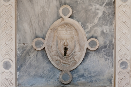 Ancient fountain on the street, in Venice, Italy. photo