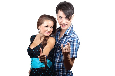 A young happy couple showing thumbs up, isolated over white background  photo