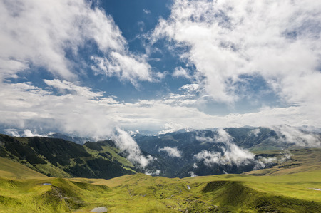 Colorful landscape with blue cloudy sky in Rodnei mountains, Romania