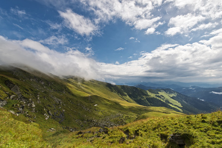 Beautiful landscape with blue cloudy sky in Rodnei mountains, Romania Stock Photo