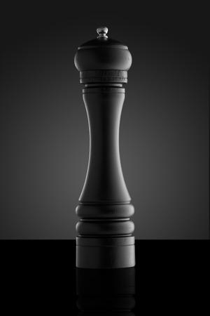 pepper grinder: Black pepper grinder isolated on black background