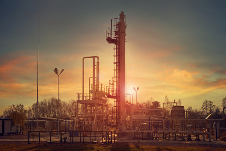 Natural gas compression processing plant for dehydration at sunset