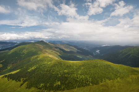 Summer landscape with blue sky and clouds in the carpathian mountains, Romania Stock Photo