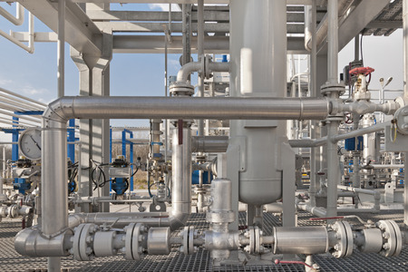 Details of a modern natural gas processing plant with pressure dials on gasworks pipes Stock Photo