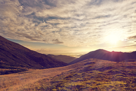 Sunny day is in the mountain landscape. Retro photo effect. Stock Photo