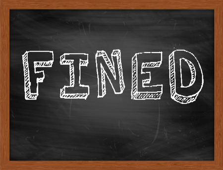 fined: FINED  hand writing text on black chalkboard